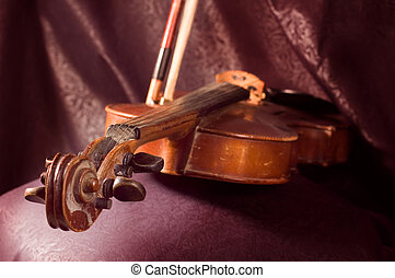 Violin - A vintage violin instrument on dark background