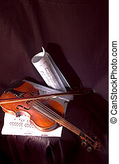Violin and note - Violin and musical note on sheet of paper