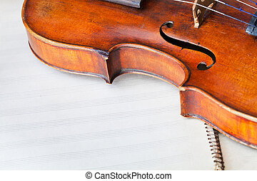 violin bout with f-hole on music book