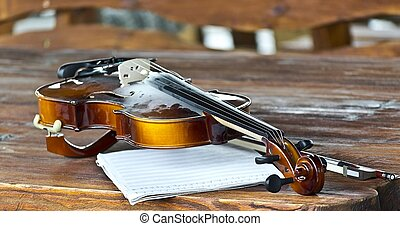 violin bow notes on a wooden table