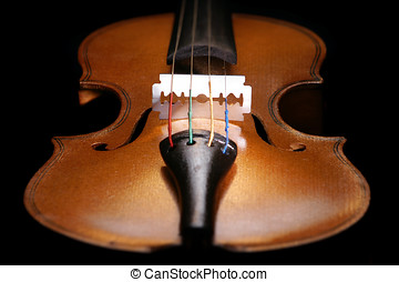 Violin close up with a razor blade at the place of the...
