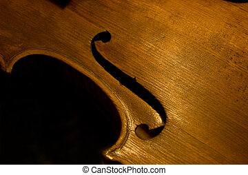 Violin - Detail of a violin f-hole of a fiddle being...