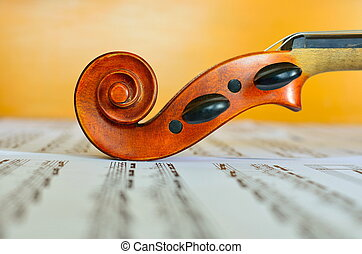 violin head over music notes