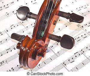 violin neck on sheet music