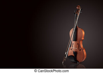 Violin on a black gradient background. Place for text