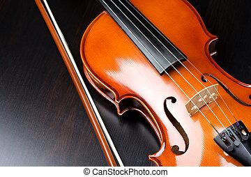 Violin on a dark desk