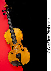 Violin on a multi-colored background, top view