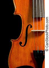 Solid wood violin or fiddle on black background