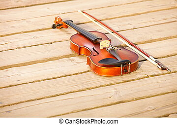 Violin on wooden pier. Music concept - Violin and string on...