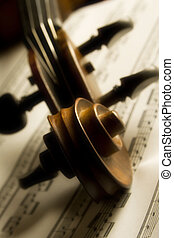 Violin - Shot of violin head over partiture, soft focus...