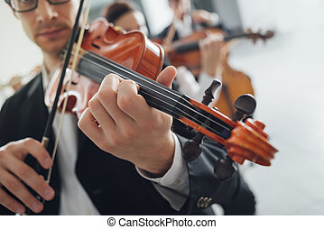 Violin players performing