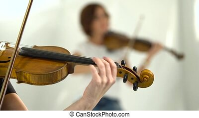 Violin playing closeup blurred background - Close up of a...