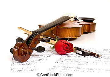 Violin, rose and music - A violin a rose and sheet music on...