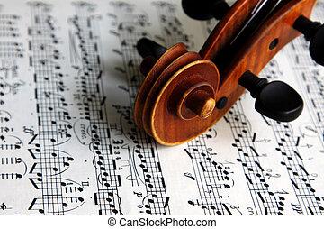 violin scroll on sheet music