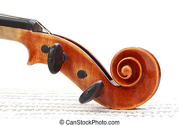 Violin Scroll  - Violin scroll on sheet music
