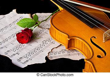 Violin sheet music and rose black composition still life...