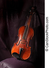 Violin - A vintage violin instrument on dark background