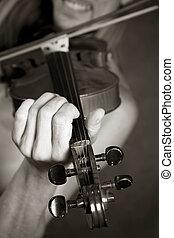 Violin - The man playing its violin close-up