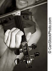 Violin - The man playing its violin close-up