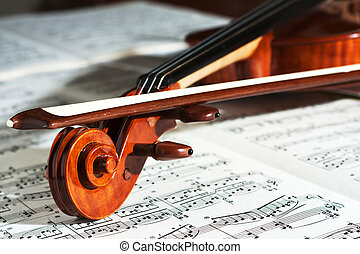 Violin with the score - Detail of a beautiful violin with...