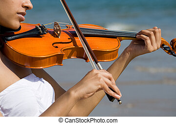 violinist - a young indian woman playing violin