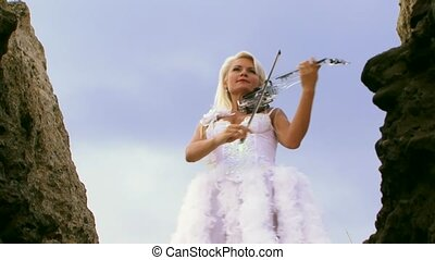 Violinist In A Beautiful White Dress