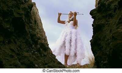 Violinist In The Mountains Playing An Instrument - Beautiful...