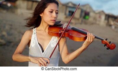 violinist on the beach