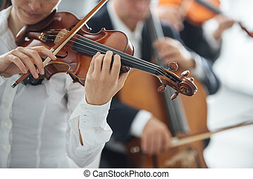 Violinist performing with orchestra
