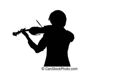 Violinist performs on a violin in a white studio.White...
