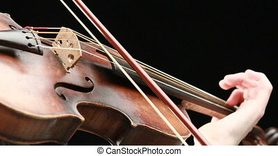 violinist playing - closeup of her hands - classical...