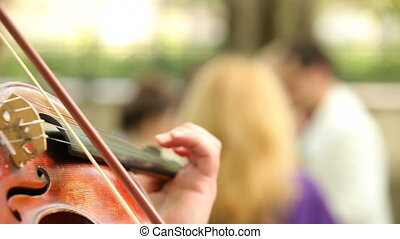Violinist playing - Close up on a violonist playing on a...