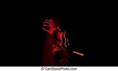 Violinist plays in the dark