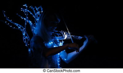 Violinist plays the violin - Beautiful blonde girl playing...