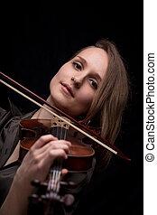 violinist woman looking at camera