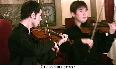 violinists and violoncellist. Panorama - Violinists and...