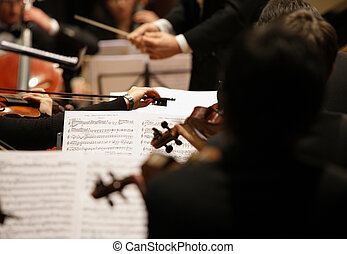 violinists during a concert - violinists during a classical...