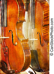 Violins on grunge backgroun