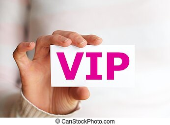 vip or very important person concept with hand and paper