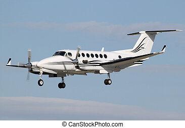 vip plane landing - a vip prop plane landing