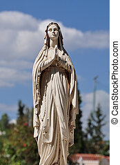 Virgin Mary hands joined in prayer marble funerary statue.