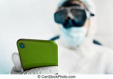 Virologist with smartphone