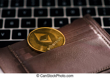 Virtual currency wallet. Ethereum gold coin. Cryptocurrency concept.