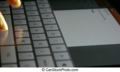 Virtual Keyboard, Typing an email on a touchscreen keyboard, Shallow depth of field.