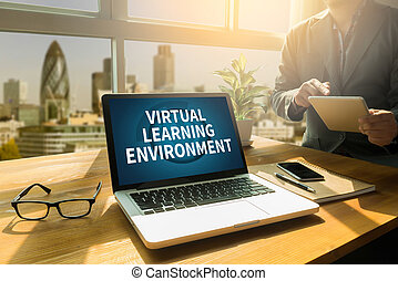 VIRTUAL LEARNING ENVIRONMENT Thoughtful male person looking to the digital tablet screen, laptop screen, Silhouette and filter sun