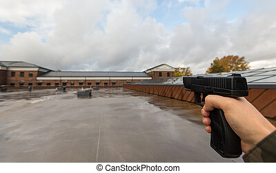 POV of male hands shooting with semi-automatic gun - virtual...