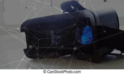 Digital composite of a virtual reality headset on top of a table. Lines and dots are seen on foreground