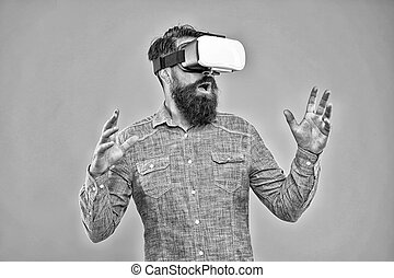 Virtual reality is truly here. Bearded man wear virtual reality headset. Hipster explore virtual reality yellow background. Virtual reality technology and future. VR communication. Video training