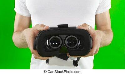 Virtual reality mask. Close up. Green screen - Virtual...