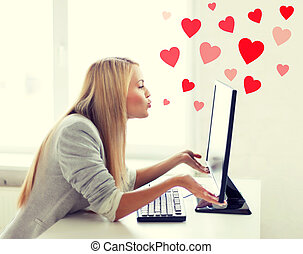 woman sending kisses with computer monitor - virtual...